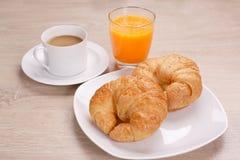 Café de petit déjeuner et jus d'orange images libres de droits