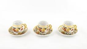 Café de porcelaine et tasse de thé antiques sur le blanc Photographie stock libre de droits