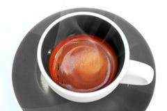 Café del café express en cierre de la taza para arriba. Imagen de archivo