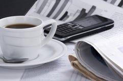 Café do copo na notícia de negócio Imagem de Stock