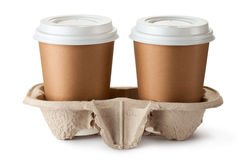 Café dois take-out no suporte Imagem de Stock Royalty Free