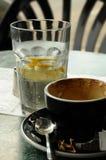 Café e água mineral Imagem de Stock Royalty Free