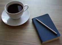 Café e bloco de notas Imagem de Stock Royalty Free