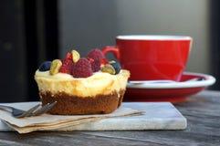 Café e bolo de queijo Fotografia de Stock Royalty Free