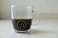 Café em um copo com um botão do poder Foto de Stock