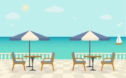 Café en la terraza cerca del mar Fotos de archivo libres de regalías