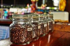 Café en los tarros de cristal Imagen de archivo libre de regalías