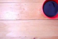 Café en taza roja Foto de archivo libre de regalías