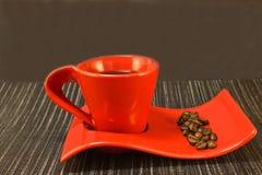 Café en taza roja Imagenes de archivo