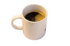 Café en una taza Imagenes de archivo