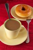 Café et beignet Photographie stock libre de droits
