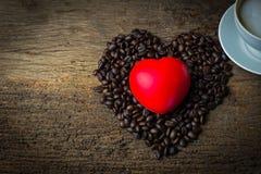 Café et coeur de tasse Photo stock