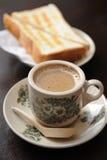 Café et pain grillé Image stock
