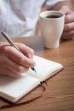 Café et plans de matin pour le jour Images libres de droits