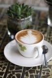Café et plante Images libres de droits