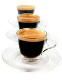 Café express dans des cuvettes transparentes Images libres de droits