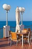 Café exterior com opinião do mar Fotografia de Stock Royalty Free