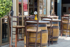 Café France. Café France, wooden barrels, tables, wooden chairs, flower in a vase, no people, photography close Stock Photography