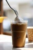 Café glacé en verre en plastique Photographie stock libre de droits