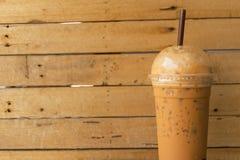 Café helado en la madera de la tabla Fotografía de archivo libre de regalías