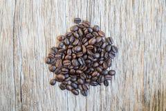 Café no fundo de madeira do grunge Imagem de Stock Royalty Free