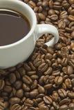 Café noir et haricots Image stock