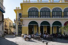 Café on Plaza Vieja and Calle Mercaderes in Havana, Cuba royalty free stock images