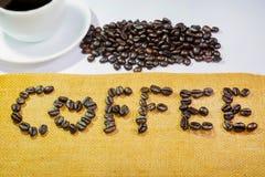 Café por los granos de café Imagenes de archivo