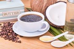 Café a prueba de balas con aceite de coco virginal y mantequilla orgánica Imágenes de archivo libres de regalías