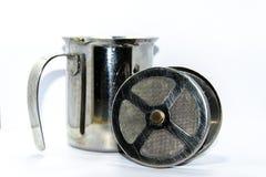 Café que espumejea la jarra Fotografía de archivo