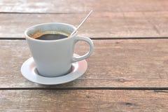 Café sur le fond en bois Photo stock