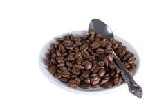 Café sur une soucoupe avec la cuillère Photographie stock libre de droits