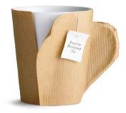 Café, thé, cuvette, tasse enveloppée vers le haut en papier brun Photos stock