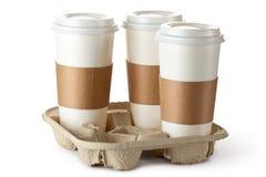Café três para viagem no suporte Fotografia de Stock Royalty Free