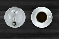 Café y bombillas Imagen de archivo libre de regalías
