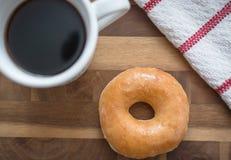 Café y buñuelo fotografía de archivo