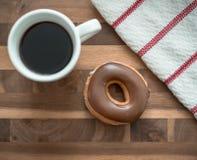 Café y buñuelo imagenes de archivo