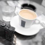 Café y cámara Imagen de archivo