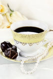 Café y chocolates foto de archivo