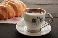 Café y cruasán Foto de archivo
