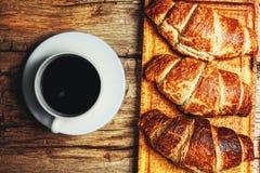 Café y cruasán Foto de archivo libre de regalías