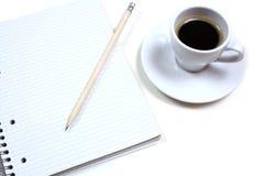 Café y cuaderno Imágenes de archivo libres de regalías