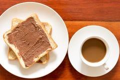 Café y pan de la mañana foto de archivo