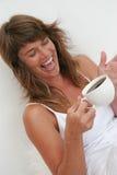 Café y risa Foto de archivo