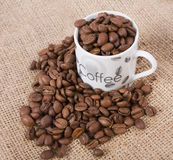 Café y taza imagen de archivo