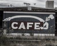 Café y teléfono abandonados Imagenes de archivo