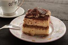 Café y torta en una tabla Foto de archivo