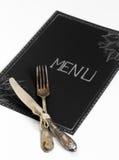 Cafémenürestaurant auf dem schwarzen Blatt mit einem weißen Hintergrund Stockbild