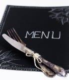 Cafémenürestaurant auf dem schwarzen Blatt mit einem weißen Hintergrund Lizenzfreie Stockfotos