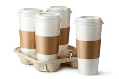 Café para llevar cuatro. Tres tazas en sostenedor. Fotografía de archivo libre de regalías